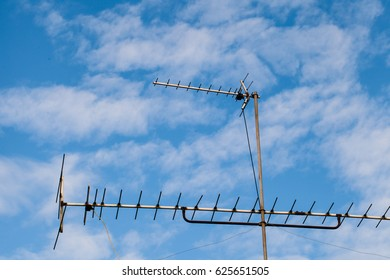Antenna against and blue sky background