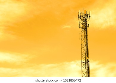 Antenna broadcast signal telecommunication in an orange sky background.