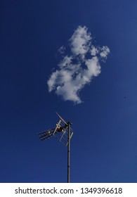 Antenna and cloud in blue sky.