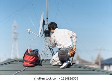 Antenna installation works at a rooftop.