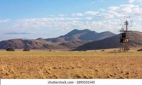 Antenna in the middle of nowhere with mountains in the back near Aus, Namibia.