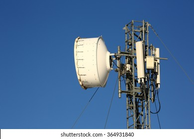 Antenna for mobile phones on blue background