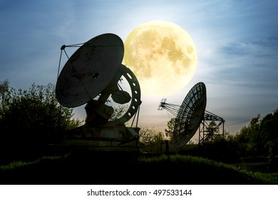 Antenna radio telescope of the Pulkovo Observatory on the background of the full moon in St. Petersburg. image contains content NASA.