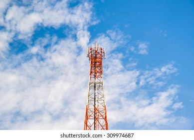 Antenna repeater tower on blue sky and white cloud, telecommunication concept.