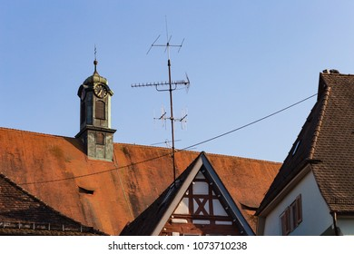 antenna and rooftops of historical buildings on a sunny springtime happy holiday in south germany