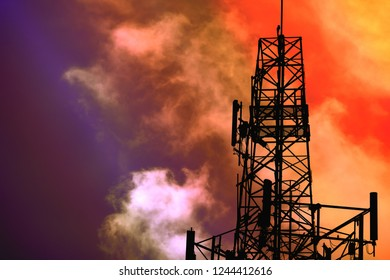 Antenna silhouette and night red cloud on sky background