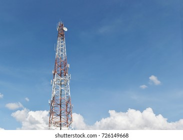 Antenna tower at blue sky and white clouds on a beautiful day