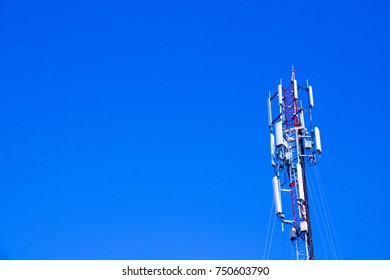 Antenna tower on blue sky background. Post antenna for sent wave Communicate in to the world.