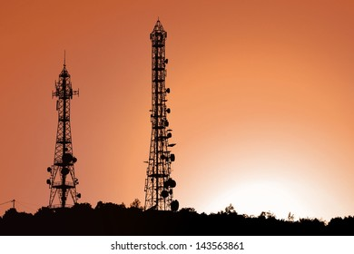 Antenna towers at sunset