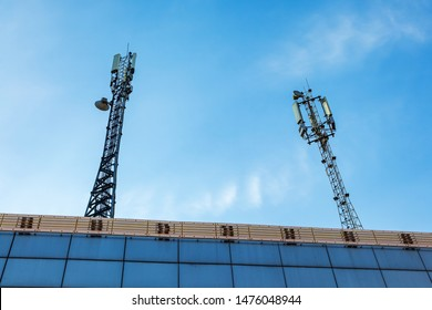 Antenna for wireless communication. Cellular systems in the city. The cell tower with 3G, 4G and 5G communications. Base station for operating mobile phones, receiving and sending a signal.
