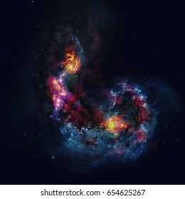 The Antennae Galaxies, NGC 4038, 4039 are a pair of distorted colliding spiral galaxies in the constellation of Corvus. Elements of this image furnished by NASA.
