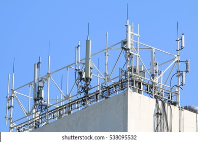 Antennas of cellular and communication systems with the blue sky background in the morning.