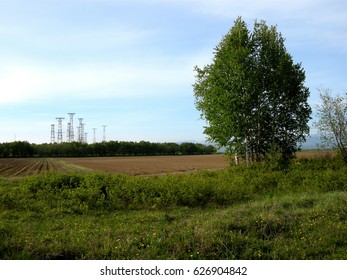 Antennas on the background of a farm