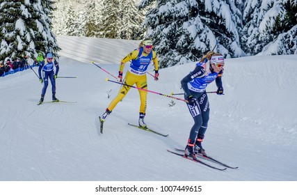 Anterselva/Antholz, Italy - JANUARY 18, 2018: Elisa Gasparin of Switzerland and Ingela Andersson of Sweden compete in the sprint at the BMW IBU World Cup Biathlon 6