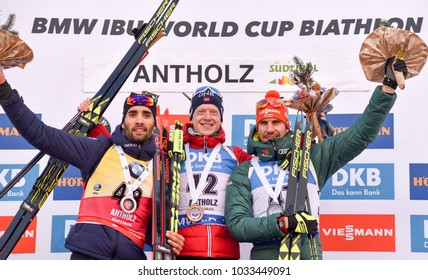 Anterselva-Antholz / Italy - JANUARY 19, 2018: Johannes Thingnes Boe of Norway, Martin Fourcade of France and Arnd Peiffer of Germany on the podium of the sprint at the BMW IBU World Cup Biathlon 6