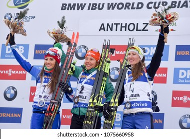 Anterselva/Antholz, Italy - JANUARY 20, 2018: Dorothea Wierer of Italy, Laura Dahlmeier of Germany and Daria Domracheva of Belarus on the podium of the pursuit at the BMW IBU World Cup Biathlon 6