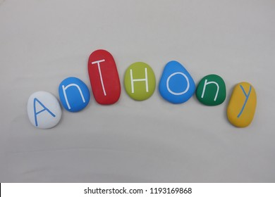 Anthony, masculine given name with colored stones over white sand