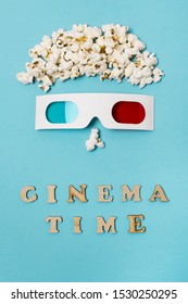 Anthropomorphic face made with popcorns and 3d glasses over the cinema time text against blue backdrop