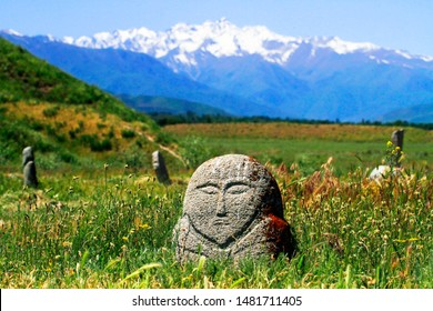 "Anthropomorphic stone or Kurgan stone or ""balbal"" near Burana tower and ruins of lost city of Balasagun, on the Silk Road, Kyrgyzstan"