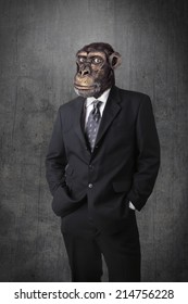 Anthropomorphous chimpanzee dressed and standing like a businessman