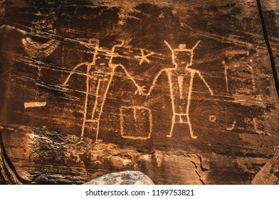 """Anthropomorphs, possibly warriors or """"ancient aliens"""" petroglyphs carved by the Fremont indians on Mcconckie Ranch in Dry Fork Canyon near Vernal, Utah, USA."""