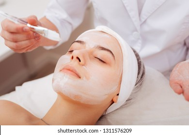 Anti aging procedure. Pleasant young woman having a facing mask while wanting to look young