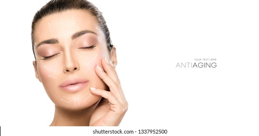 Anti aging treatment and plastic surgery concept. Beautiful young woman with hand on cheek and eyes closed with a serene expression and white arrows over face. Isolated on white with copy space
