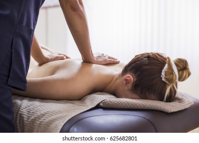 Anti cellulite massage for young woman in beauty salon