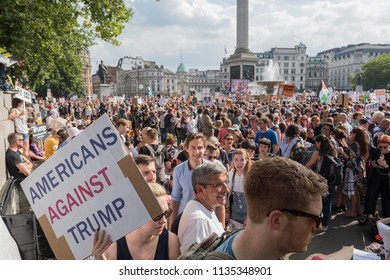 Anti Donald Trump protesters hold signs and chant in Trafalgar Square during the anti Donald Trump protests held in central London. London, UK, 07/13/18