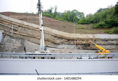 Anti landslide concrete wall protecting against rock slides and landslip on the new modern built highway