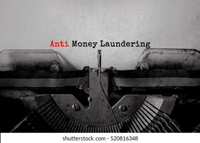 anti money laundering typed words on a vintage typewriter