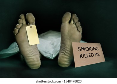Anti tobacco campaign . dead body lying at morgue with blank identity label covered with sheet and smoking kill warning billboard in lung cancer death and danger of cigarettes addiction