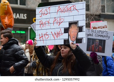 Anti Trump Border Wall Sign at Women's March On 6th Avenue In Midtown, Manhattan, USA On January 19, 2019