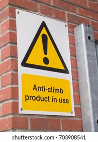 Anti vandal, anti climb paint (a non-drying tar-like paint substance) applied to the top of a metal gate with accompanying warning sign.