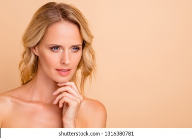 Anti-age novelty concept. Close-up portrait of attractive charming wavy-haired nude lady with flawless smooth shine fresh skin touching chin copy empty blank space place isolated on beige background