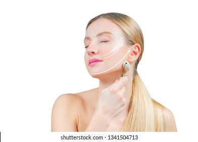 Anti-aging treatment and face lift. Beautiful woman with perfect skin and arrows on face, getting lifting massage using roller massager
