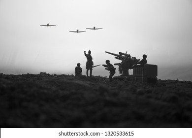 An anti-aircraft cannon and Military silhouettes fighting scene on war fog sky background. Allied air forces attacking on German positions. Artwork decorated scene. Selective focus