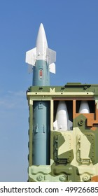 Anti-aircraft defence system. Rocket launcher and rockets in the box against a background of blue sky.