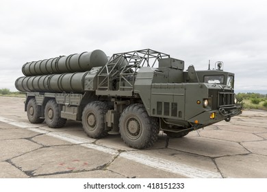 Antiaircraft missile complex, ballistic launcher with missiles ready to attack on military powerful all-terrain transportation. Modern mobile army industry equipment.