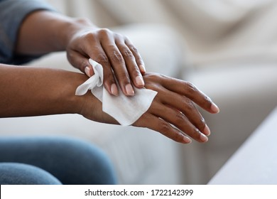 Antibacterial Wipes. African American Woman Disinfecting Hands With Wet Tissues At Home, CloseUp