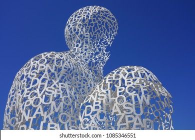 ANTIBES, FRANCE -20 APR 2018- View of the Nomade, a large white metal  sculpture by Spanish artist Jaume Plensa on the waterfront fort in the Port Vauban harbor, in Antibes, on the French Riviera.