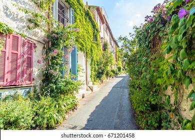 Antibes, France - July 01, 2016: day view of typical narrow street in Antibes, France. Antibes is a popular seaside town in the heart of the Cote d'Azur.