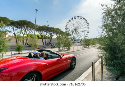Antibes, France - July 01, 2016: day view of Ferrari supercar and grande roue in Antibes, France. Port Vauban is the largest marina in the Mediterranean Sea