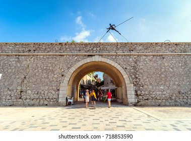 Antibes, France - July 01, 2016: Modern art sculptures on the Pre-des-Pecheurs esplanade and historic wall in old town. The area was renovated in 2014 and is popular for events.