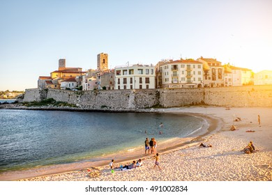 Antibes, France - June 14, 2016: Landscape view on the old coastal village and sandy beach with people in Antibes on the french riviera in France