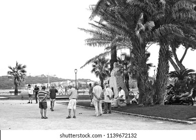 Antibes, France - June 25, 2018: Old men playing petanque in Antibes, France