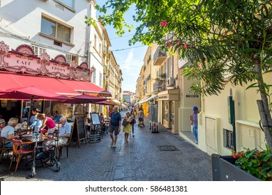 Antibes, France - June 27, 2016: day view of main street Rue de la Republique with tourists in Antibes, France. Antibes is a popular seaside town in the heart of the Côte d'Azur.