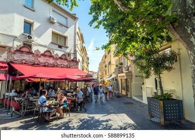 Antibes, France - June 27, 2016: day view of main street Rue de la Republique with tourists in Antibes, France. Antibes is a popular seaside town in the heart of the Cote d'Azur.