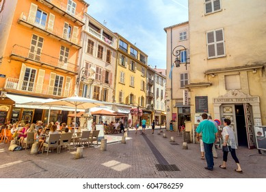 Antibes, France - June 29, 2016: day view of typical dowmtown street in Antibes, France. Antibes is a popular seaside town in the heart of the Cote d'Azur.
