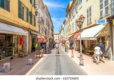Antibes, France - June 29, 2016: day view of typical narrow downtown street in Antibes, France. Antibes is a popular seaside town in the heart of the Cote d'Azur.